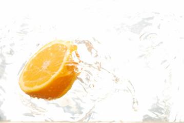 Orange half spashing in water