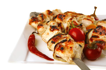 roast chicken shish kebab on white