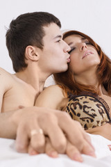 Young couple kissing at bedroom