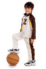 Junior boy basket ball player