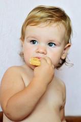 toddler girl eating cake