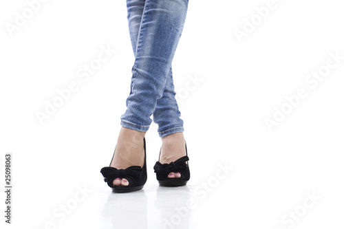 sexy legs with high heels and jeans