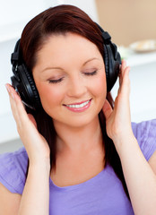 Blissful woman listen to music