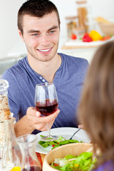Charming young man having dinner with his girlfriend