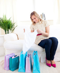 Bright woman with shopping bags at home