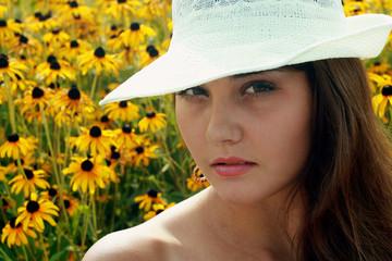 portrait girl near yellow flowerses