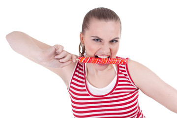 young woman bite lollipop