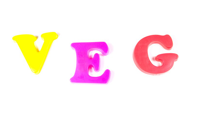veg, written in fridge magnets