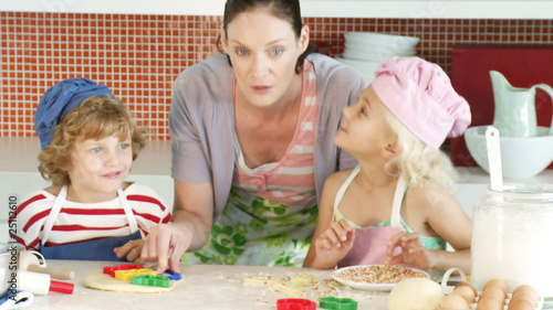 mother making pastries with her two children