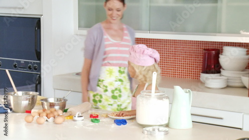 cute mother baking with her daughter