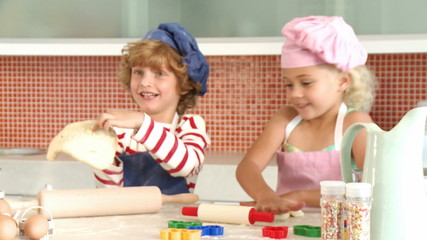 cute brother and sister baking together
