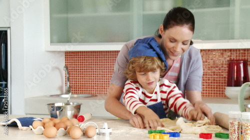 little chef baking with his mother in the kitchen