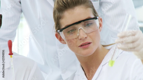 young female chemist with a probe