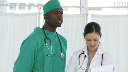 Afro surgeon with a nurse