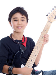happy smiling child playing guitar