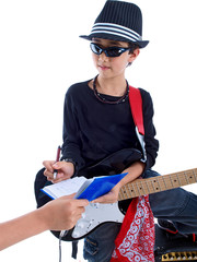child celebrity writing an autograph for a fan