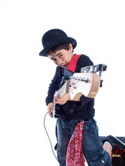 smiling child playing electric guitar