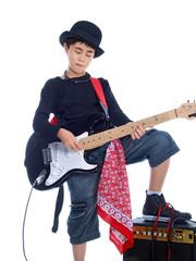 child plucking electric guitar
