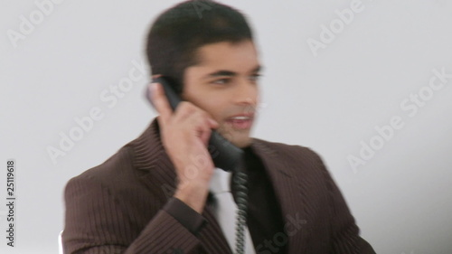 Hispanic Businessman talking on his phone