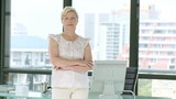 confident senior businesswoman standing up in her office