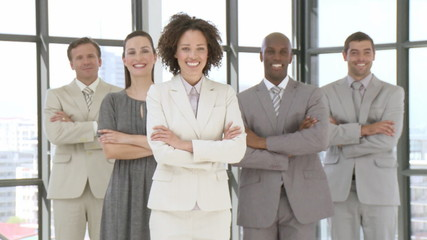 Multi-ethnic Business team standing with folded arms