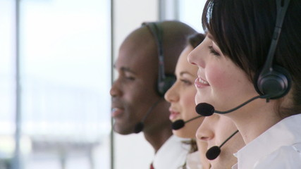 Multi-ethnic Business team talking on headsets