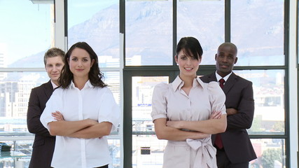Determinded Business team standing with arms folded