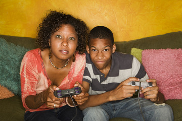 African-American family playing video game