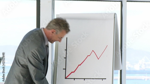 close-up of a ceo explaining results with graphs