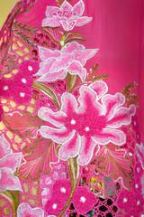 Dark pink Kebaya cloth with white flowers