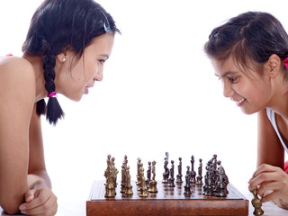 sisters playing chess isolated on white background
