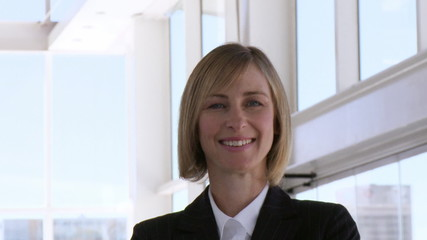 Smart business woman smiling at the camera
