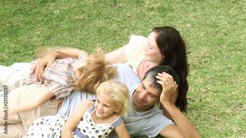 portrait of a family lying on the grass