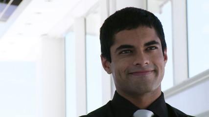 portrait of a  smiling hispanic businessman