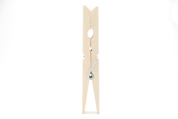 The wooden clothespin stand-up on the white background