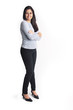 Young woman with arms crossed full body portrait isolated