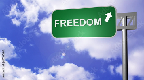 signpost on the road showing freedom