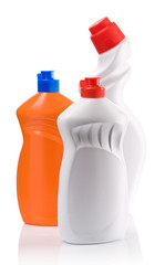 orange and white bottles for clean