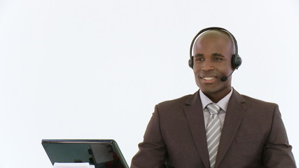african man working in a call center