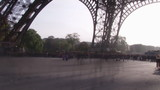 People Moving with Abstract ghosting Effect under Eiffel Tower