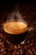 Espresso on coffee beans