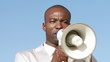 African businessman giving instructions through a megaphone