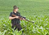 Jäger im Mais