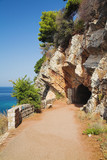 Entrance to the tunnel in the rock, Petrovac, Montenegro poster