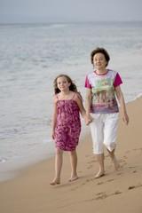 Grandmother And Granddaughter At Seashore, Maui, Hawaii, Usa