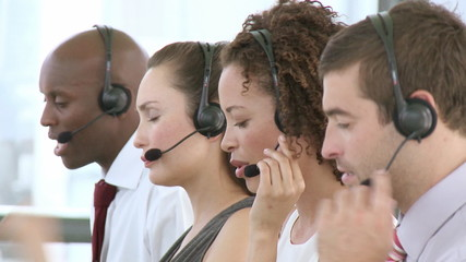 businesspeople with headsets on