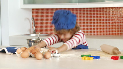 young boy baking alone in the kitchen