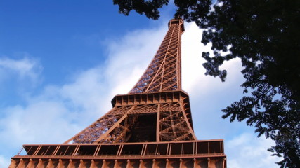 Eiffel tower with clouds animation on the background