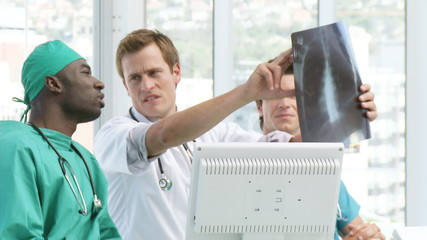 handsome doctors looking at an x-ray