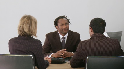 african manager resolving a conflict between two colleagues